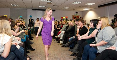 model at charity fashion show with audience
